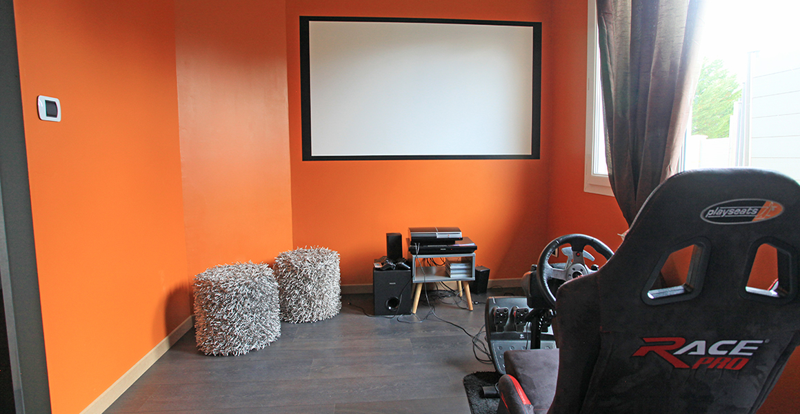 Computer games room with projector and large screen