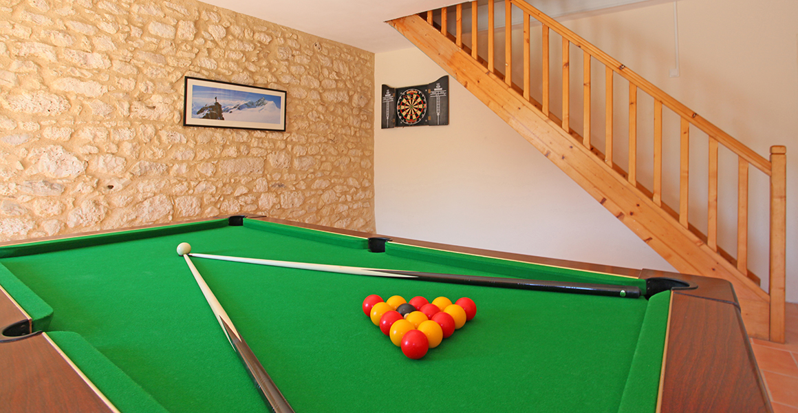 The games room with stairs up to the cinema room