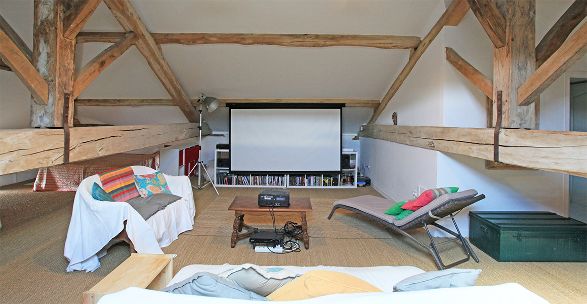 There's plenty of books and games in the 'den' with a large screen and projector
