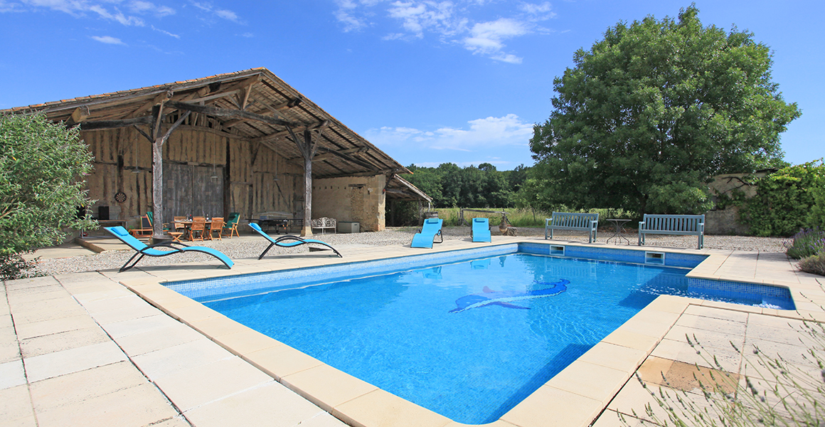 The pool and open barn dining area and table tennis table