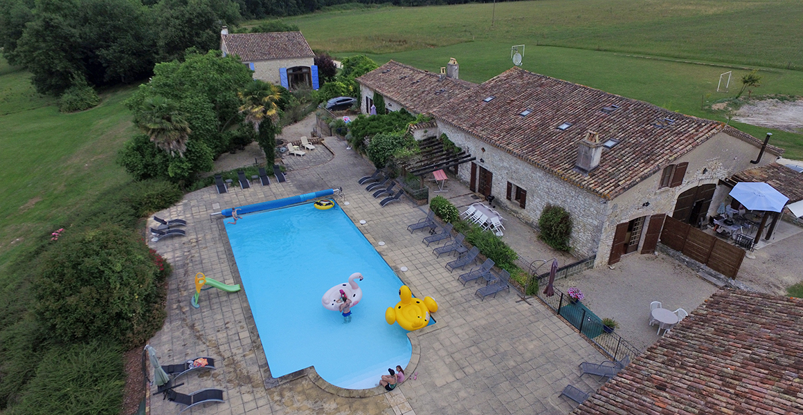 Ferme is in the foreground, next to the pool