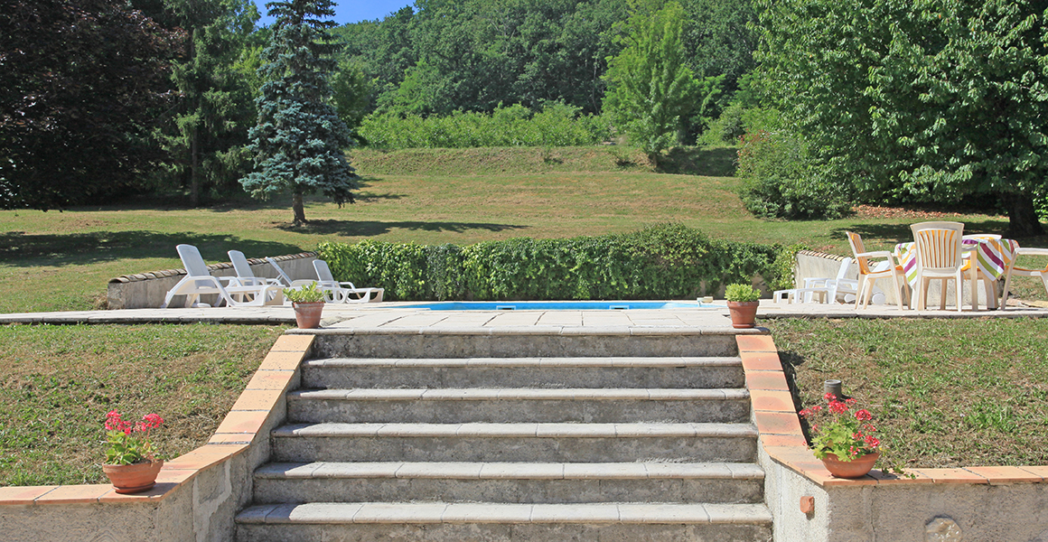 The upper terrace and steps up to the pool